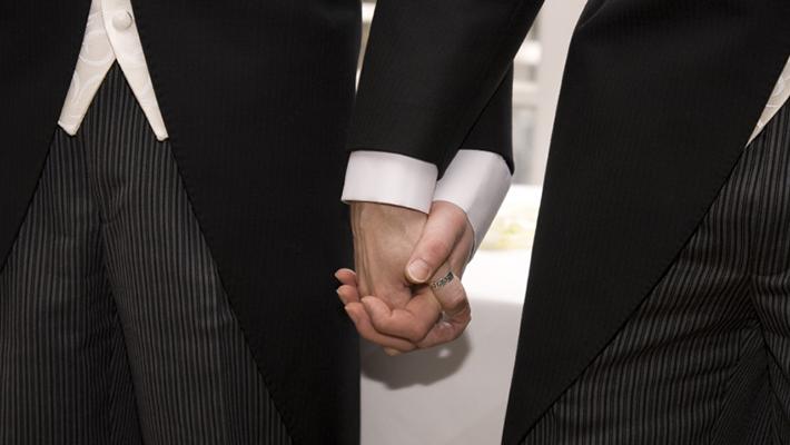 Gay couple having their wedding in Santorini, Greece www.weddingingreece.com
